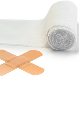 Band-aid and tensor bandage on a white background photo