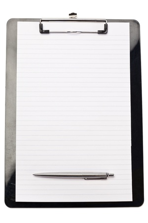 Pen at the bottom of note pad on a white background photo