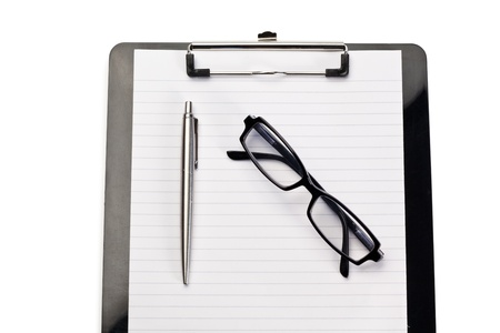 Note pad, pen and glasses on a white background photo