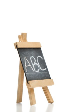Angled chalkboard with the letters abc written on it isolated against a white background photo