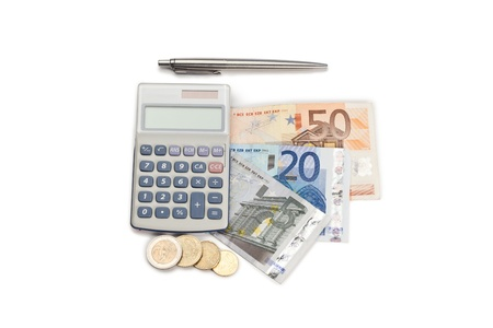Coins and cash with pen and pocket calculator on a white background photo