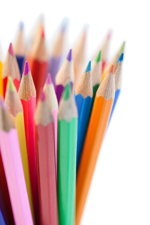 Mixing of horizontal color pencils on a white background photo