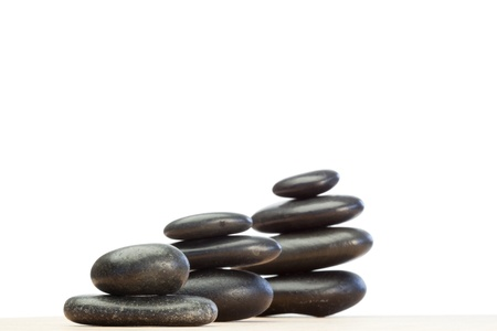 Differents piled up pebbles on a white background Stock Photo - 10194224