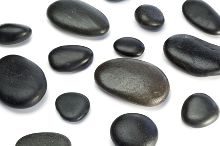 Spaced out pebbles lying on a white background photo