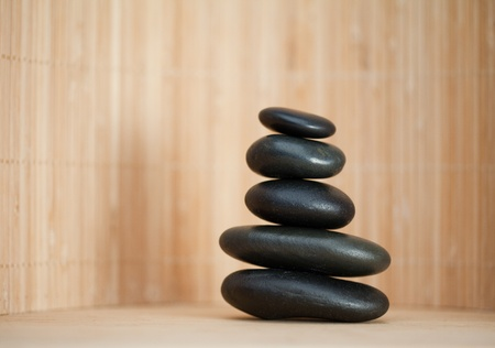 Several piled up pebbles on a brown background Stock Photo - 10206792
