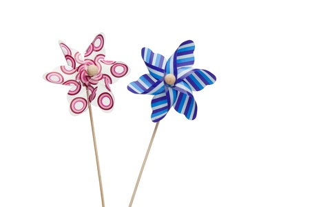 Pink and blue paper windmills on a white background Stock Photo - 10194098