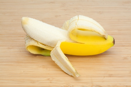 Peeled banana on a desk photo