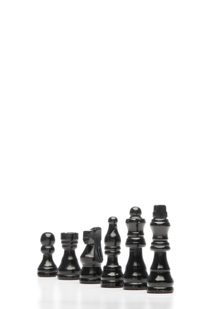 Dark pieces of chess on a white background photo