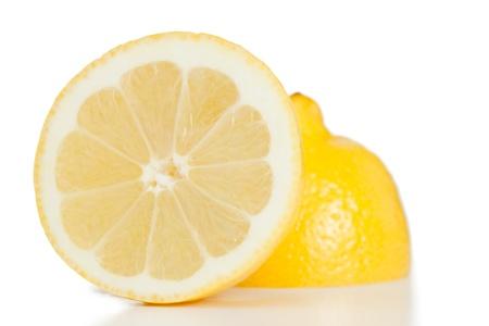 Yellow halved lemon on a white background photo