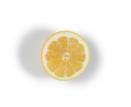 Half yellow lemon on a white background photo