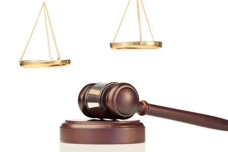 Fixed gavel and golden scale of justice on a white background photo