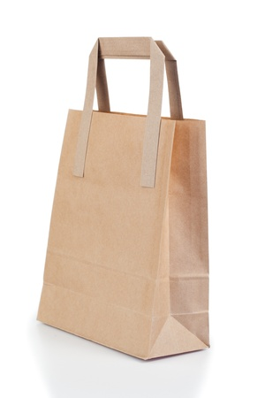 Angled brown paper bag on a white background photo