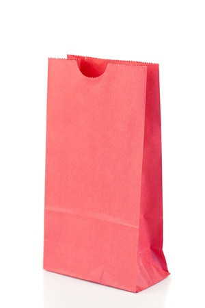 Angled pink paper bag on a white background photo