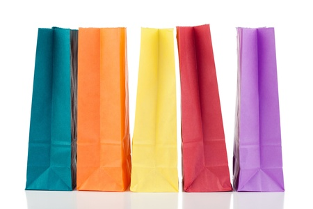 Colored paper bags on a white background photo