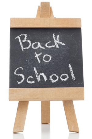 Chalkboard with the words back to school written on it isolated against a white background photo