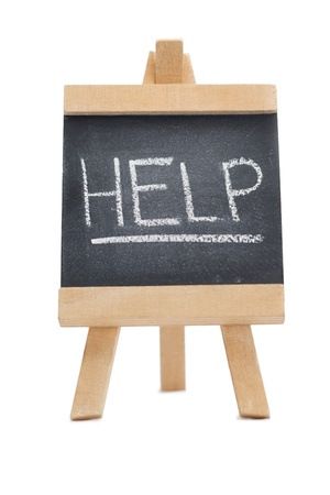 Chalkboard with the word help written on it isolated against a white background photo