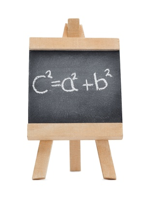 Chalkboard with a mathematical formula written on it isolated against a white background photo