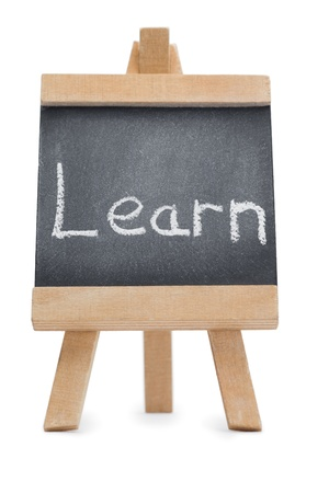 Chalkboard with the word learn written on it isolated against a white background photo