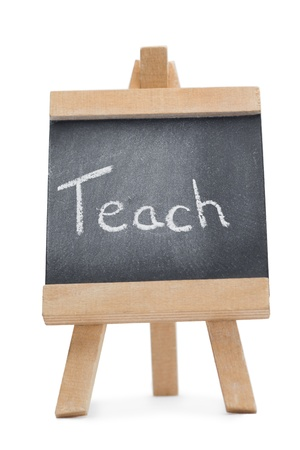 Chalkboard with the word teach written on it isolated against a white background photo