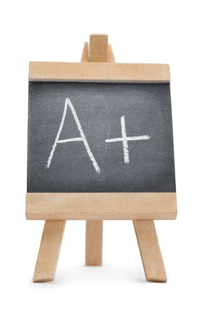 Chalkboard with the letter a and the symbol + written on it isolated against a white background Stock Photo - 10198559