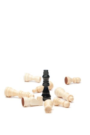 Dark king and white pieces of chess on a white background photo