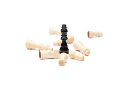 Black king and white pieces of chess on a white background photo