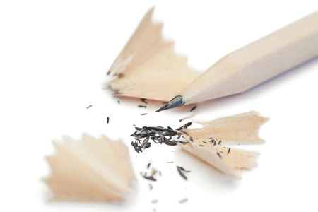 White pencil and its peelings on a white background photo