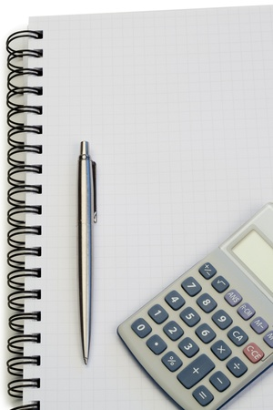 compute: Notebook with pencil and pocket calculator on a white background
