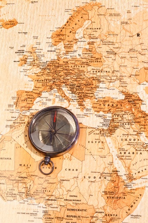 World map with compass showing North Africa and Europe photo