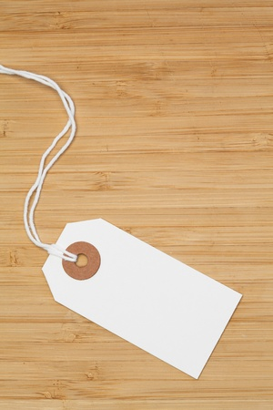 White tag isolated on a desk photo
