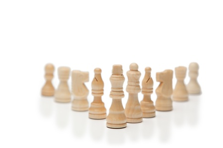 White pieces of chess on a white background photo
