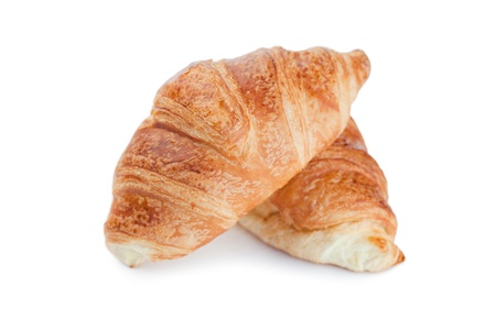 Golden croissants on a white background  photo