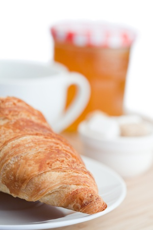 Breakfast with coffee marmalade and croissants on a white background photo
