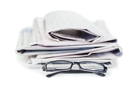 newsprint: Newspapers and black glasses on a white a background