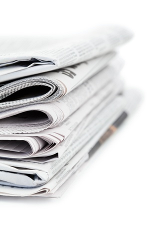 Newspapers and black glasses on a white a background Stock Photo - 10196196