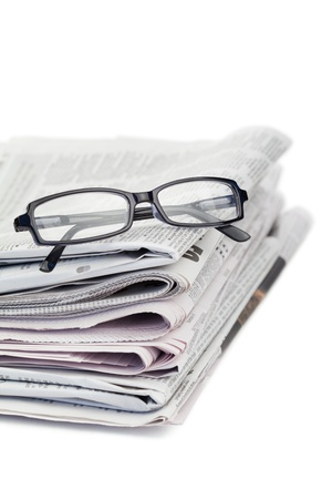 Newspapers and black glasses on a white a background Stock Photo - 10195749
