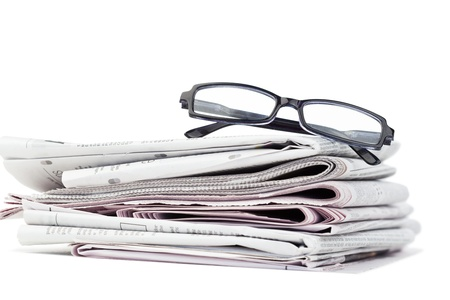 Newspapers and black glasses on a white a background Stock Photo - 10196116