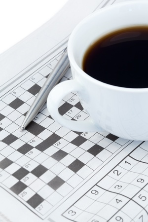 brainteaser: Newspapers and crossword puzzle on a white background