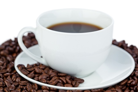 Cup of coffee and coffee beans on a white background Stock Photo - 10198336