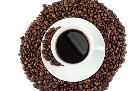 Cup of coffee and coffee beans on a white background photo
