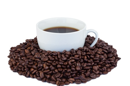 Small cup of coffee and coffee beans on a white background Stock Photo - 10197911