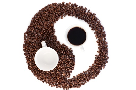 Brown and white symbol made of coffee beans on a white background photo