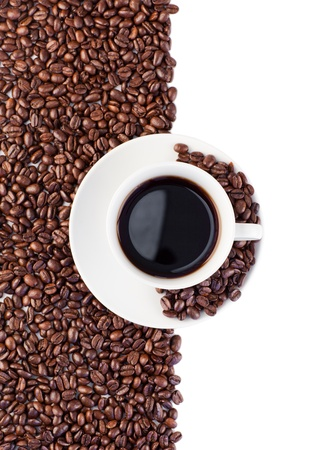Cup of coffee and beans on white and made of beans background photo