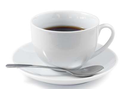 Cup of coffee with spoon and saucer on a white background photo