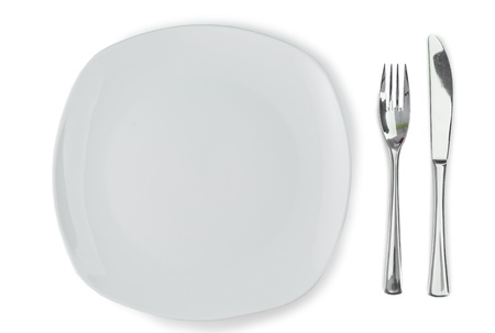 Plate and cultery on a white background photo