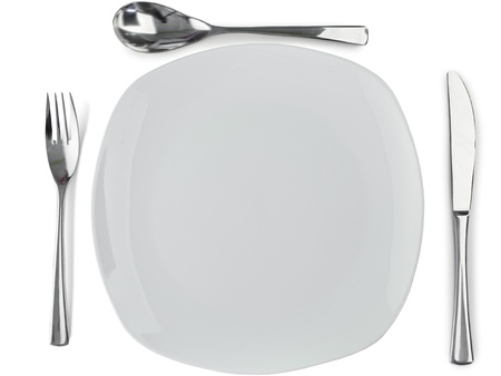 Cultery around plate on a white background photo