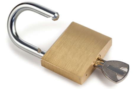 Open golden padlock on a white background photo