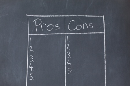 Table with numbers opposing pros and cons on a blackboard photo