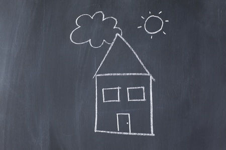 House with sun and cloud on a blackboard photo