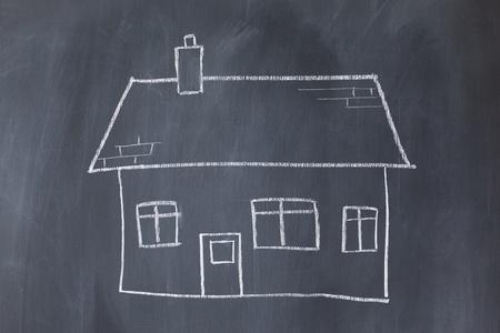 Big house on a blackboard photo
